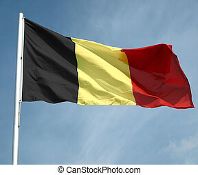Flag of Belgium over a blue sky