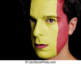 Flag of Belgium Painted on a Face of a Young Man