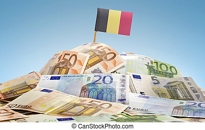 Flag of Belgium sticking in a pile of various european ...