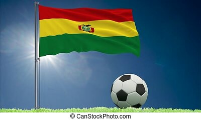Flag of Bolivia fluttering and a football rolls, 3d...