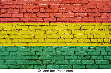 Flag of Bolivia painted on brick wall, background texture