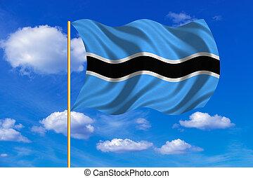 Flag of Botswana waving on blue sky background
