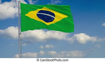 Flag of Brazil against background of clouds sky