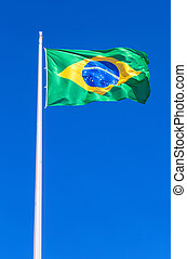 Flag of Brazil flying in the wind against the sky