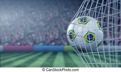 Flag of Brazil on the football hitting goal net back. Realistic slow motion 3D animation