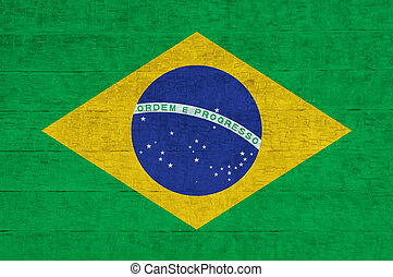 Flag of Brazil painted on cement wall, background texture