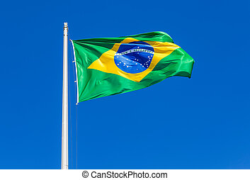 Flag of Brazil waving in the wind against the sky
