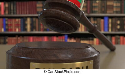 Flag of Bulgaria on falling judges gavel in court. National...