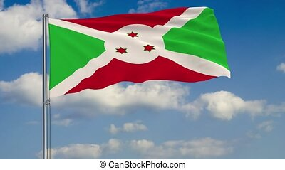Flag of Burundi against background of clouds