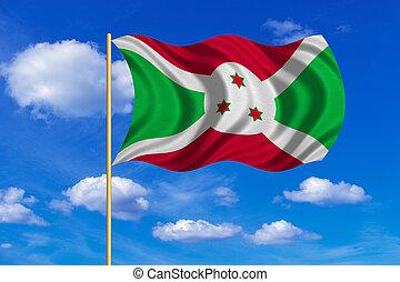 Flag of Burundi waving on blue sky background