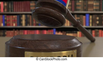 Flag of Cambodia on falling judges gavel in court. National...
