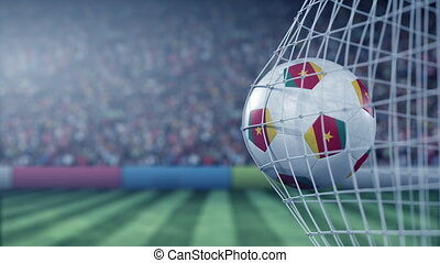 Flag of Cameroon on the football hitting goal net back. Realistic slow motion 3D animation
