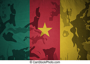 flag of cameroon on the khaki texture . military concept