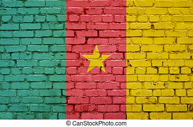 Flag of Cameroon painted on brick wall, background texture