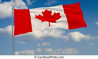 Flag of Canada against background of clouds