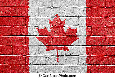 Flag of Canada on brick wall