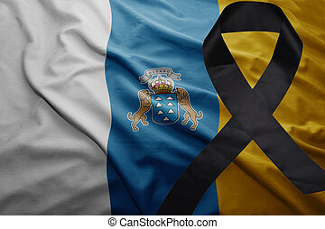 flag of canary islands with black mourning ribbon