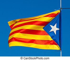 flag of Catalonia against blue sky