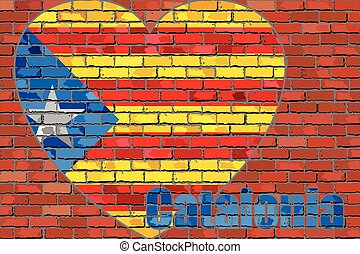 Flag of Catalonia on a brick wall in heart shape