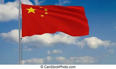 Flag of China against background of clouds sky