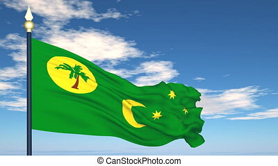 Flag Of Cocos (Keeling) Islands on the background of the sky and flying clouds.
