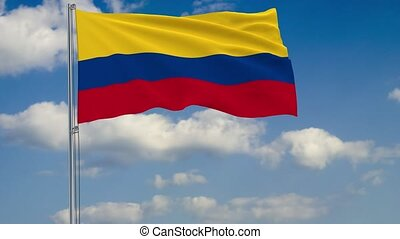 Flag of Colombia against background of clouds