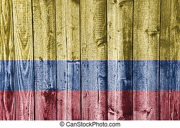 Flag of Colombia on weathered wood