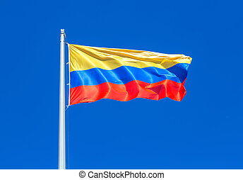 Flag of Columbia waving in the wind against the sky