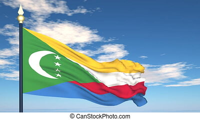 Flag Of Comoros on the background of the sky and flying...