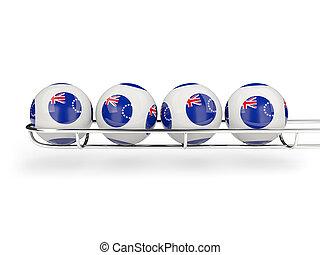 Flag of cook islands on lottery balls. 3D illustration
