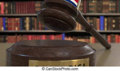 Flag of Costa Rica on falling judges gavel in court....