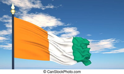 Flag Of Cote d'ivoire on the background of the sky and...