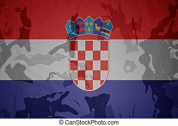 flag of croatia on the khaki texture . military concept