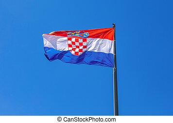 Flag of Croatia waving in the wind against the sky