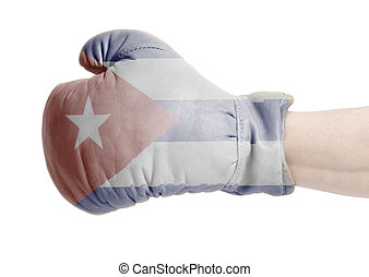 Flag of Cuba on boxing gloves wearing in male hand