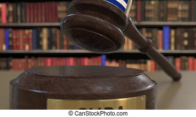 Flag of Cuba on falling judges gavel in court. National...