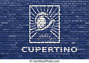 flag of Cupertino painted on brick wall