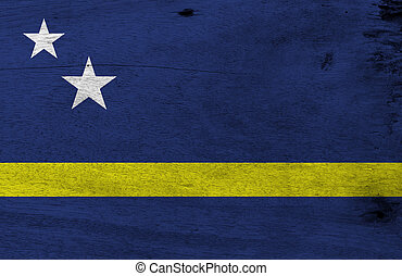 Flag of Curacao on wooden plate background. Grunge Curacao flag texture, blue field with a horizontal yellow stripe slightly below the midline and two white stars.