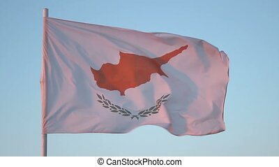 """Flag of Cyprus flapping in wind, national symbol against blue sky, loopable shot"""