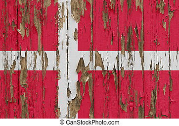 Flag of Denmark on a weathered wooden wall