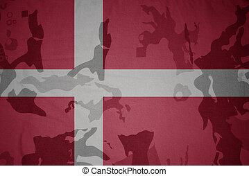 flag of denmark on the khaki texture . military concept