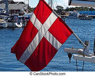 Flag of Denmark up high on a sail yacht