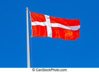 Flag of Denmark waving in the wind against the sky