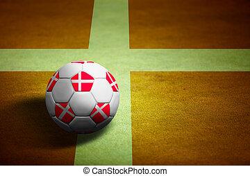 Flag of Denmark with soccer ball over grass background -...