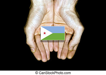 Flag of Djibouti in hands on black background