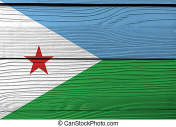 Flag of Djibouti on wooden wall background. Grunge Djibouti flag texture, horizontal light blue and light green with a white triangle and red star.