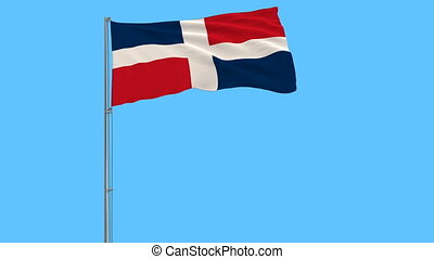 Flag of Dominican on the flagpole fluttering in the wind on pure blue background, 3d rendering