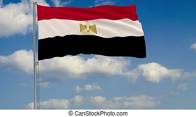 Flag of Egypt against background of clouds
