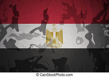 flag of egypt on the khaki texture . military concept