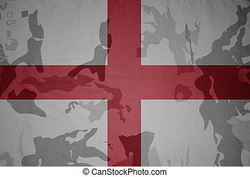 flag of england on the khaki texture . military concept